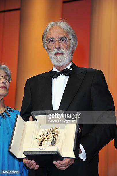 Director Michael Haneke receives the Palme D'Or for 'Amour' onstage at the Closing Ceremony during the 65th Annual Cannes Film Festival on May 27...