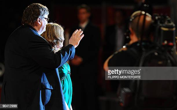 """Director Michael Moore and his wife Kathleen Glynn arrive for the screening of """"Capitalism: A love story"""" at the Venice film festival on September 6,..."""