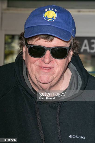 Director Michael Moore arrives ahead the 72nd annual Cannes Film Festival at Nice Airport on May 23 2019 in Nice France