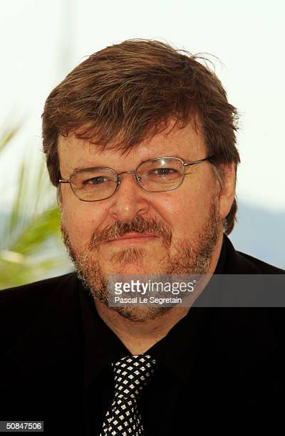 Director Michael Moore attends the photocall for Fahrenheit 9/11 at the Palais des Festivals during the 57th Annual International Cannes Film...