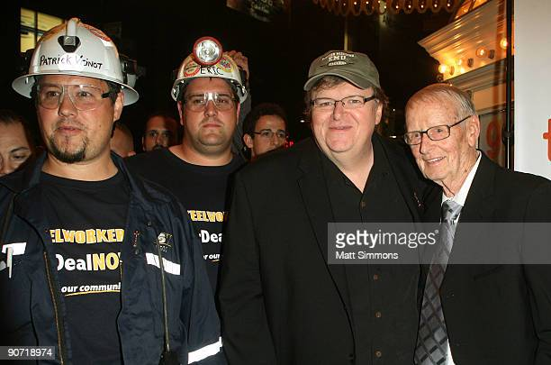 Director Michael Moore Father Frank Moore with AntiCapitalist demonstrators attends 'Capitalism A Love Story' Premiere held at Visa Screening Room at...