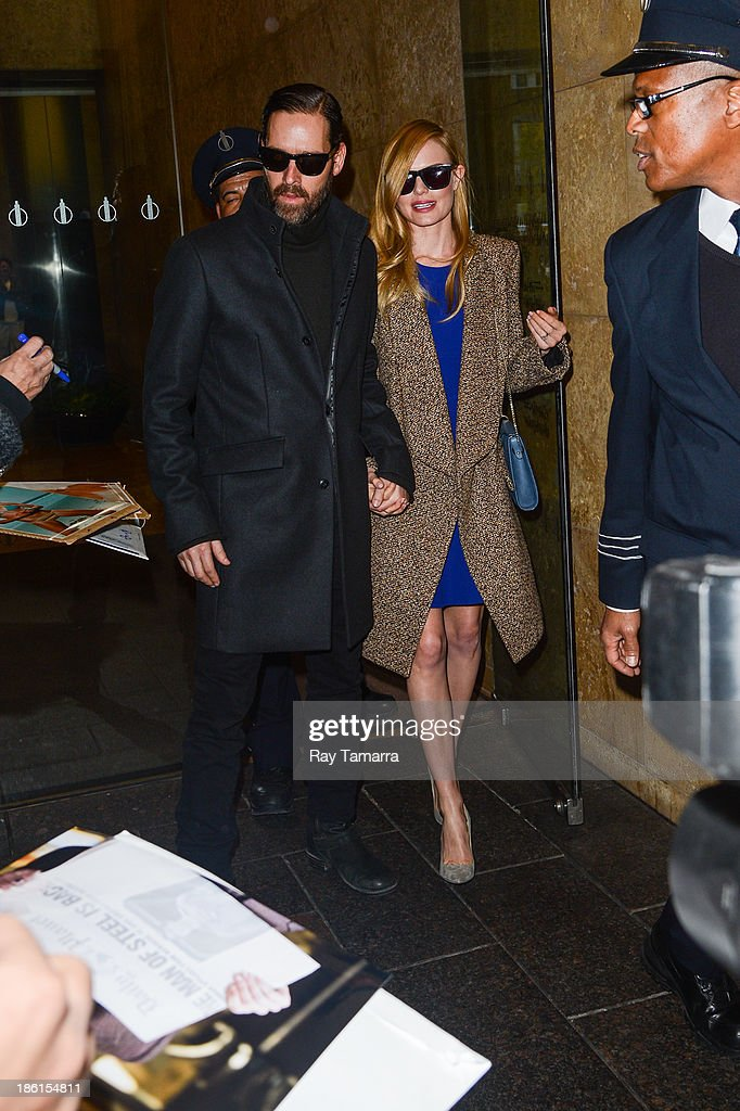 Director Michael Polish (L) and actress Kate Bosworth leave the Sirius XM Studios on October 28, 2013 in New York City.