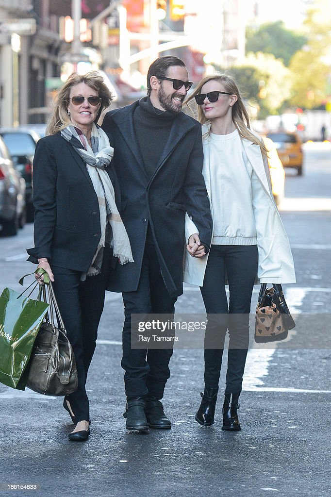 Director Michael Polish (L) and actress Kate Bosworth walk in Soho on October 28, 2013 in New York City.