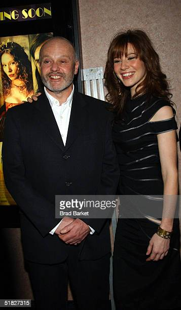 "Director Michael Radford and actress Lynn Collins arrive to the premiere of ""The Merchant of Venice"" at the U/A Theatre on December 5, 2004 in New..."