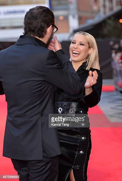 Director Michael Roskam and Noomi Rapace attend a screening of 'The Drop' during the 58th BFI London Film Festival at Odeon West End on October 11...