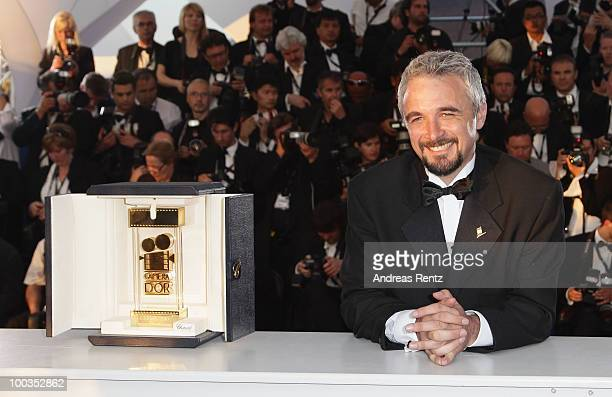 Director Michael Rowe poses with Camera D'Or award for the film Ano Bisiesto during the Palme d'Or Award Ceremony photocall held at the Palais des...