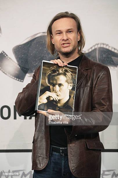 Director Michal Skolimowski holds a picture of his now deceased brother and codirector Józef Skolimowski as he attends the 'Ixjana' Photocall during...