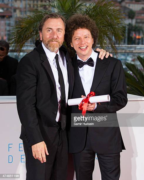 Director Michel Franco winner of the Best Screenplay Prize for his film 'Chronic' poses with actor Tim Roth attends a photocall for the winners of...