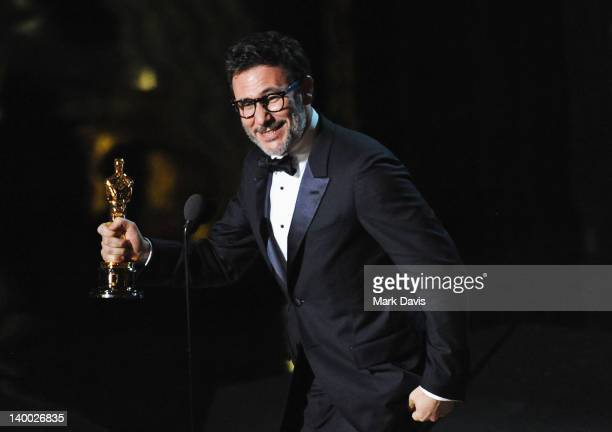 Director Michel Hazanavicius accepts award onstage during the 84th Annual Academy Awards held at the Hollywood Highland Center on February 26 2012 in...