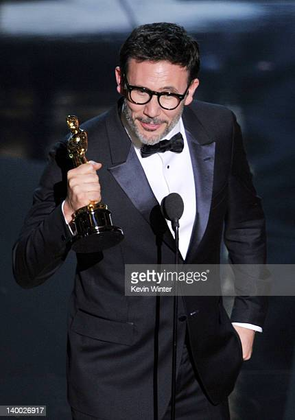 Director Michel Hazanavicius accepts the Best Director Award for 'The Artist' onstage during the 84th Annual Academy Awards held at the Hollywood...