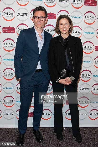 Director Michel Hazanavicius and actress Annette Bening arrive at the COLCOA French Film Festival Premiere Of The Search at Directors Guild Of...