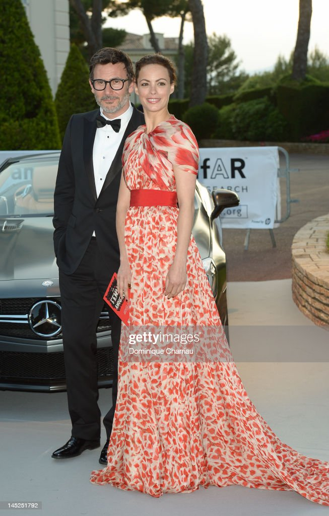 Director Michel Hazanavicius and actress Berenice Bejo arrive at the 2012 amfAR's Cinema Against AIDS during the 65th Annual Cannes Film Festival at Hotel Du Cap on May 24, 2012 in Cap D'Antibes, France.