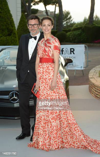 Director Michel Hazanavicius and actress Berenice Bejo arrive at the 2012 amfAR's Cinema Against AIDS during the 65th Annual Cannes Film Festival at...
