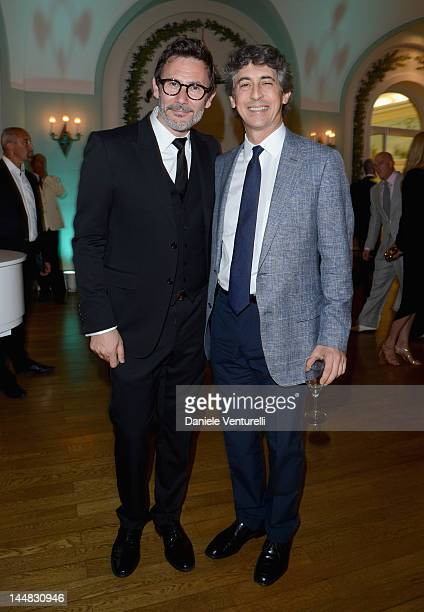 Director Michel Hazanavicius and Alexander Payne attend the Vanity Fair and Gucci Party at Hotel Du Cap during 65th Annual Cannes Film Festival on...