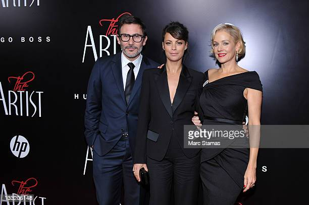 """Director Michel Hazanavicius, Berenice Bejo and Actress Penelope Ann Miller attend the premiere of """"The Artist"""" at the Paris Theater on November 17,..."""