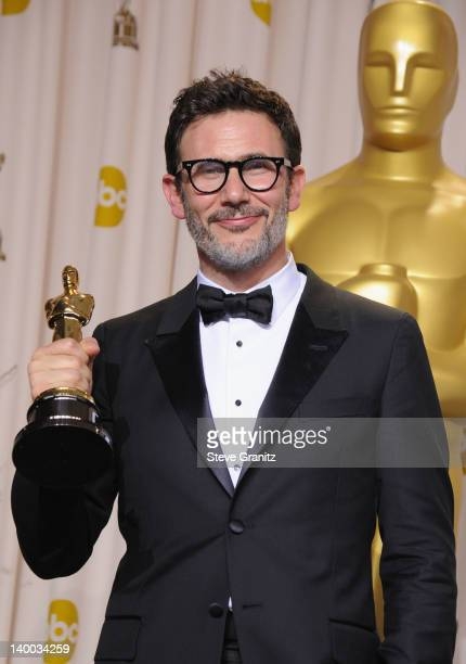 Director Michel Hazanavicius poses in the press room at the 84th Annual Academy Awards held at the Hollywood Highland Center on February 26 2012 in...