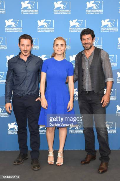 Director Michele Alhaique actress Greta Scarano and actor Pierfrancesco Favino attend the 'Senza Nessuna Pieta' photocall during the 71st Venice Film...