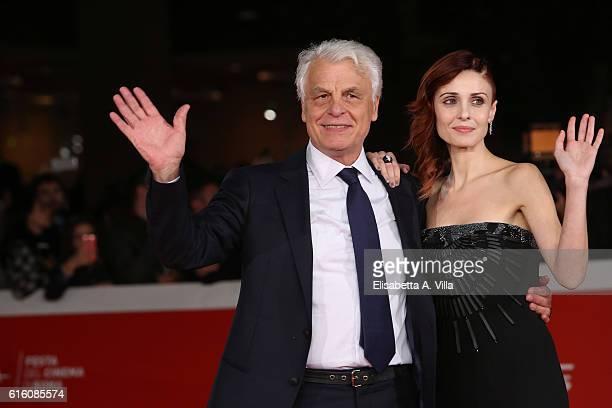 Director Michele Placido and Federica Vincenti walk the red carpet for '7 Minuti' during the 11th Rome Film Festival at Auditorium Parco Della Musica...