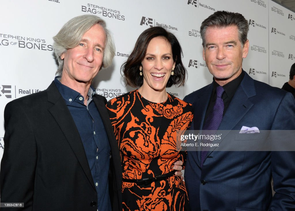 Director Mick Garris, actress Annabeth Gish and actor Pierce Brosnan attend A&E's premiere party event for Stephen King's 'Bag of Bones' at Fig & Olive Melrose Place on December 8, 2011 in West Hollywood, California.