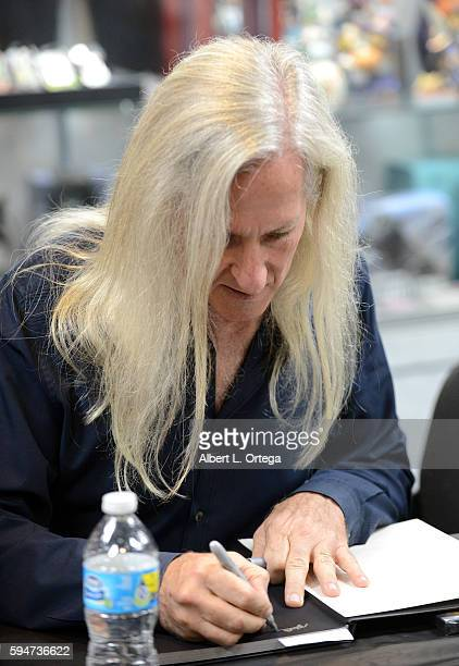 Director Mick Garris signs copies of the BluRay Psycho IV The Begining at the John Landis Book Signing For Monsters In The Movies with Mick Garris at...