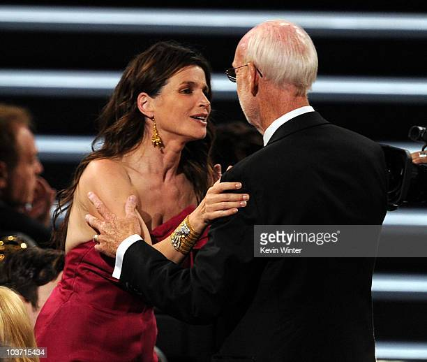 Director Mick Jackson accepts the Outstanding Made for Television Movie award for Temple Grandin with actress Julia Ormond at the 62nd Annual...