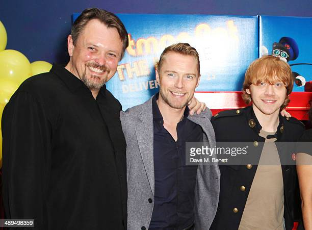Director Mike Disa Ronan Keating and Rupert Grint attend the World Premiere of 'Postman Pat' at Odeon West End on May 11 2014 in London England