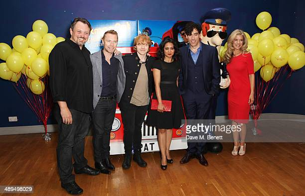Director Mike Disa Ronan Keating Rupert Grint Parminder Nagra Stephen Mangan and Susan Duerden attend the World Premiere of 'Postman Pat' at Odeon...