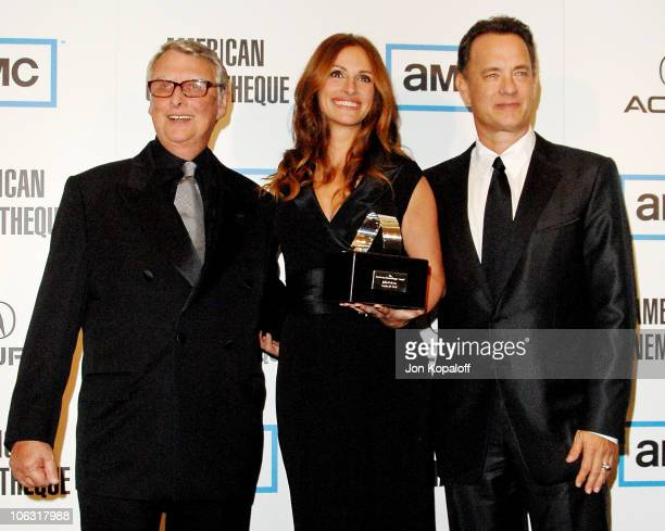 Director Mike Nichols actress Julia Roberts and actor Tom Hanks pose at the American Cinemateque Honors Julia Roberts at the Beverly Hilton Hotel on...