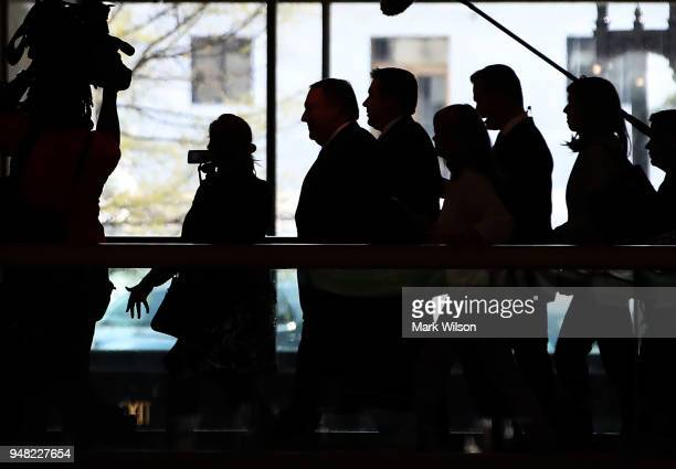 Director Mike Pompeo is trailed by media as he leaves a Senate Intelligence Committee closed door meeting on Capitol Hill April 18 2018 in Washington...