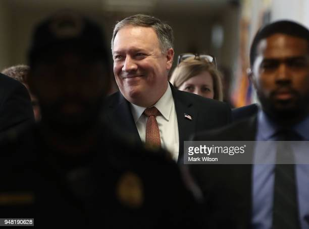 Director Mike Pompeo smiles as he walks to a meeting with Sen Mark Warner on Capitol Hill April 18 2018 in Washington DC President Donald Trump has...