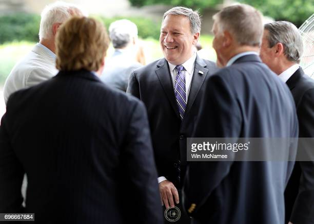 Director Mike Pompeo speaks with colleagues before delivering remarks at an event marking the 75th anniversary of the founding of the Office of...