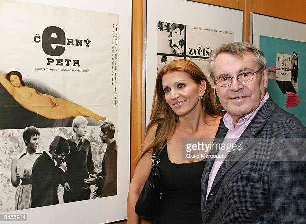Director Milos Forman and wife Martina pose in front of the poster of his movie Black Peter during An Academy Salute to his career at the Academy of...