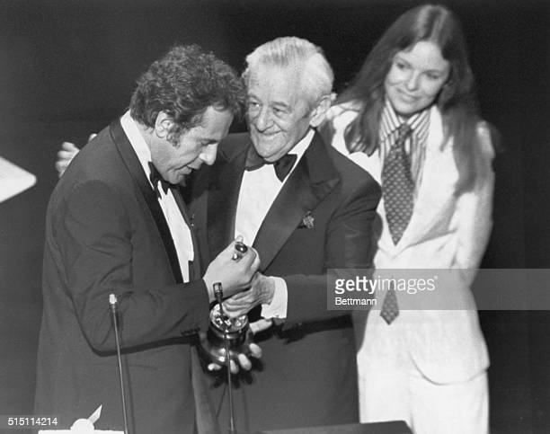Director Milos Forman is presented his Oscar for the Best Achievement in directing by William Wyler as Diane Keaton looks on at the 48th Annual...