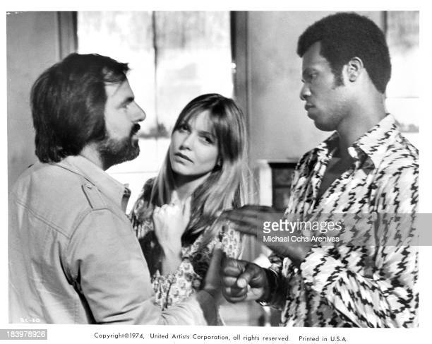 Director Milton Katselas with Actress Susan Blakely and Yaphet Kotto on set of the United Artists movie Report to the Commissioner in 1975