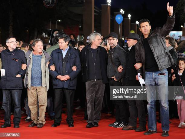 Director Mimmo Calopresti and actor Giuseppe Fiorello join protesters on the red carpet during the opening of The 5th International Rome Film...