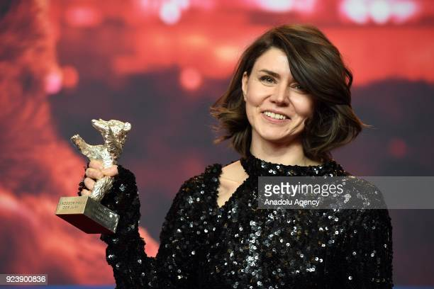 Director Monika Szumowska shows Grand Jury Prize silver bear for her film 'Twarz' during the 68th edition of the International Film Festival Berlin...