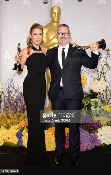 Director Morgan Neville and producer Caitrin Rogers winners of Best Documentary Feature pose in the press room during the Oscars at Loews Hollywood...