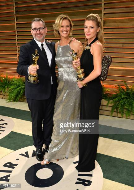 HOLLYWOOD CA MARCH Director Morgan Neville Janet Friesen and producer Caitrin Rogers attend the 2014 Vanity Fair Oscar Party Hosted By Graydon Carter...
