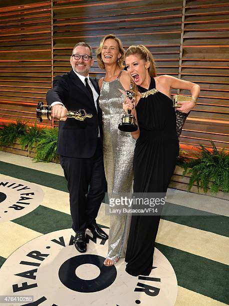 Director Morgan Neville singer Janet Friesen and producer Caitrin Rogers attend the 2014 Vanity Fair Oscar Party Hosted By Graydon Carter on March 2...