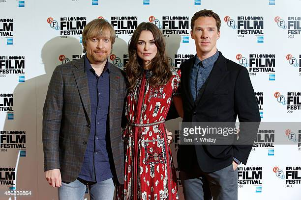 Director Morten Tyldum actress Keira Knightley and actor Benedict Cumberbatch attend the photocall for The Imitation Game during the 58th BFI London...