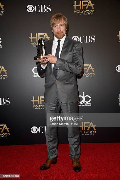 Director Morten Tyldum winner of Hollywood Director for 'The Imitation Game' poses in the press room during the 18th Annual Hollywood Film Awards at...