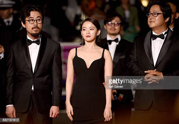 Director Na HongJin actor Kwak Dowon and actress Chun WooHee attend The Strangers Premiere during the 69th annual Cannes Film Festival at the Palais...