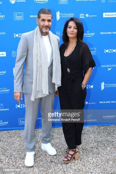 """Director Nabil Ayouch and his wife Co-screenwriter Maryam Touzani attend the """"Haut et fort"""" movie Photocall during the 14th Angouleme French-Speaking..."""