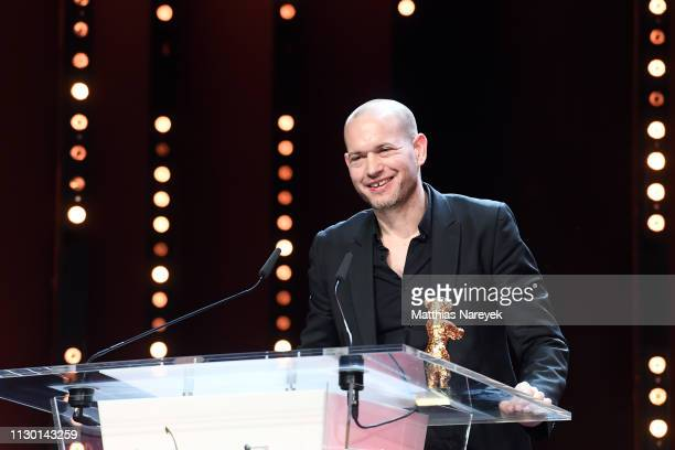 Director Nadav Lapid winner of the Golden Bear for Best Film for 'Synonymes' is seen on stage at the closing ceremony of the 69th Berlinale...