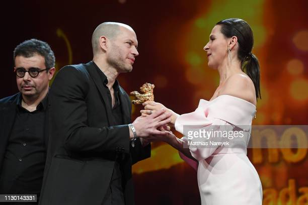 Director Nadav Lapid winner of the Golden Bear for Best Film for 'Synonymes' is seen on stage next to President of the International Jury Juliette...