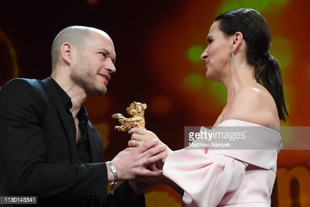 Director Nadav Lapid winner of the Golden Bear for Best Film for Synonymes is seen on stage next to President of the International Jury Juliette...
