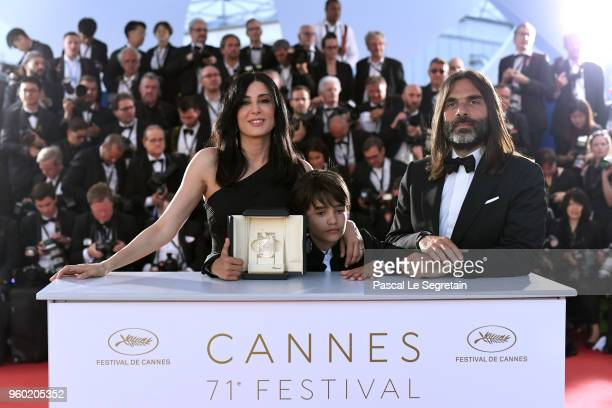 Director Nadine Labaki actor Zain Alrafeea and Composer Khaled Mouzanar pose with the Jury Prize award for 'Capharnaum 'at the Palme D'Or Winner...