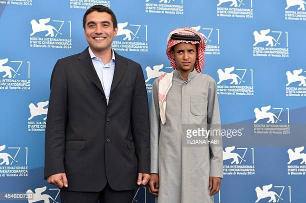 Director Naji Abu Nowar and ator Jacir Eid pose during the photocall of the movie Theeb presented in the Orizzonti selection at the 71st Venice Film...