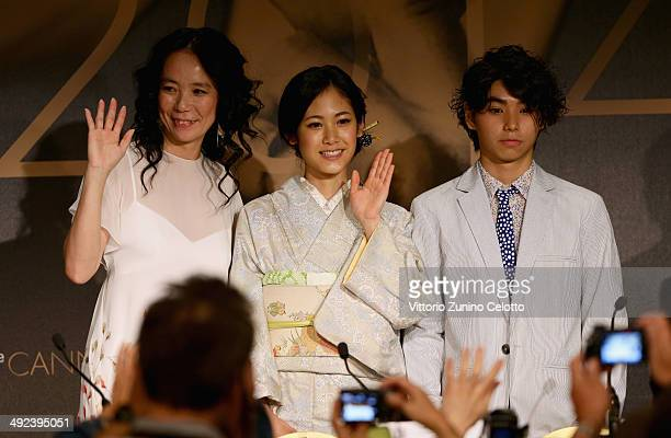 Director Naomi Kawase actors Jun Yoshinaga and Nijiro Murakami attend the 'Futatsume No Mado' press conference during the 67th Annual Cannes Film...