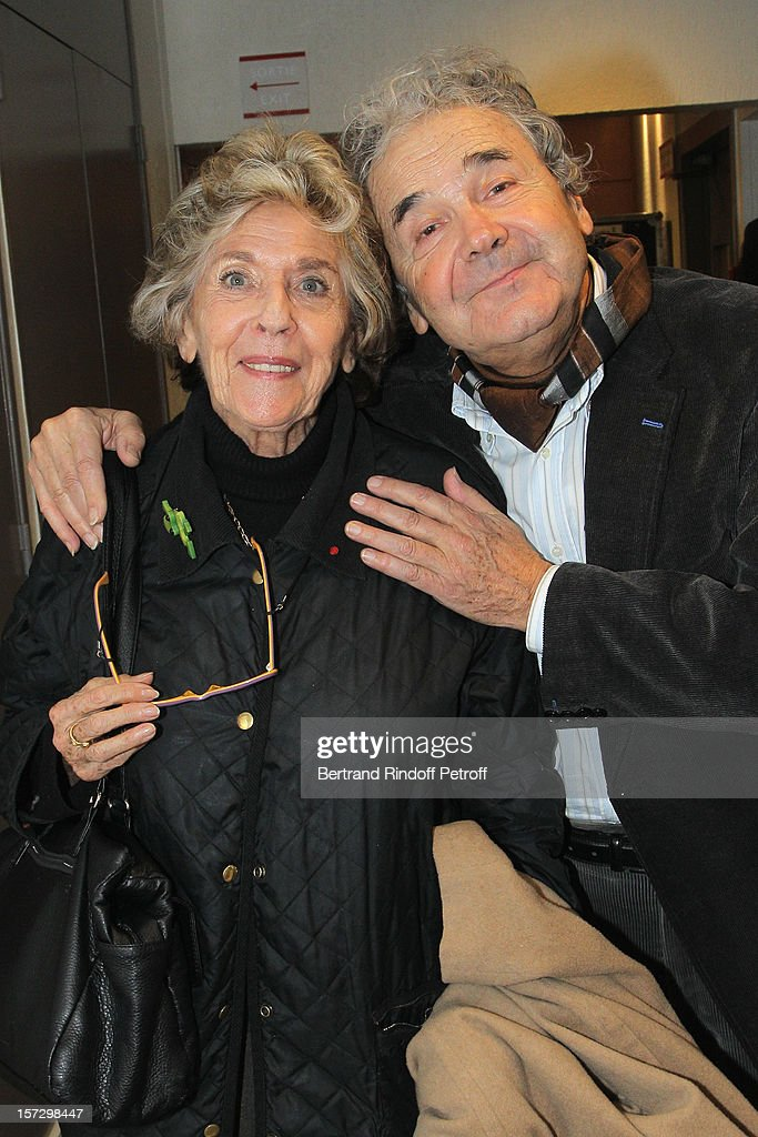 Director Nelly Kaplan (L) and singer Pierre Perret pose, in Gerra's dressing room, after French impersonator Laurent Gerra's One Man Show at Palais des Congres on November 30, 2012 in Paris, France.